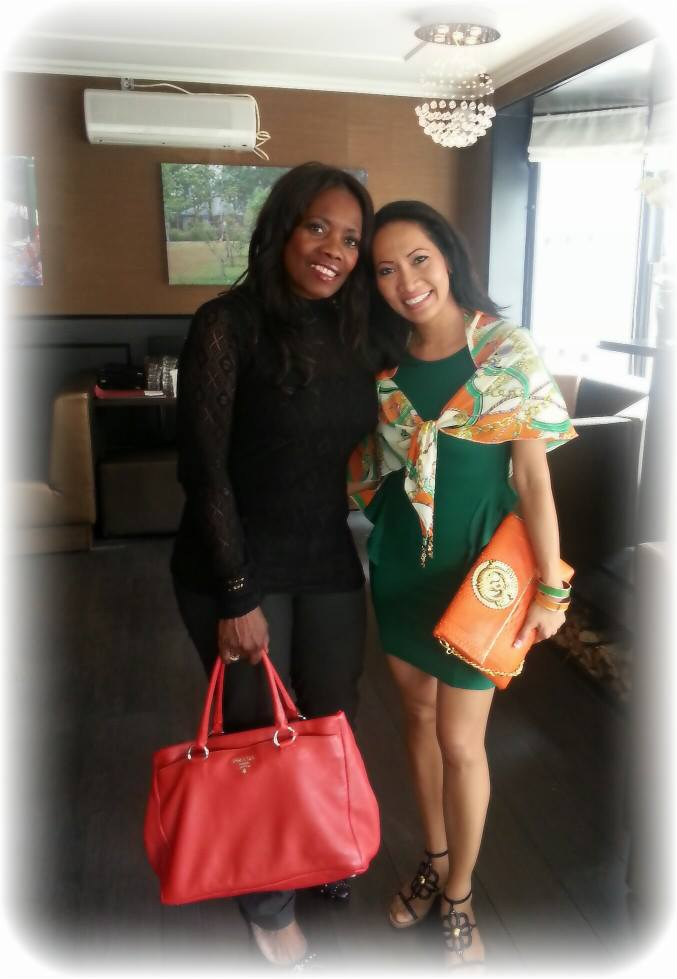 Ms. Rhiana mix and match her exotics Orange Python DRAGON Clutch with her Triangle Q~Fashion Scarf